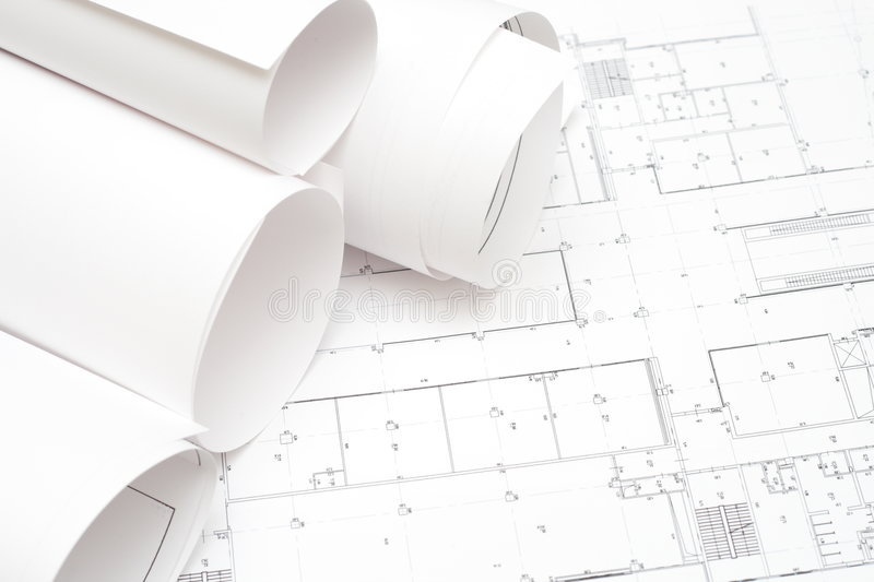 Rolled blueprints. Arhitectural construction document and plans to serve as background royalty free stock photo