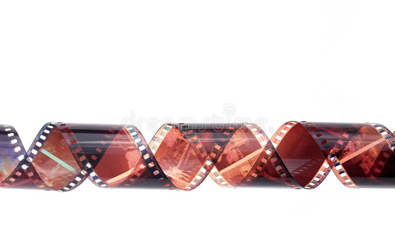 Rolled camera film strip on white background. The rolled camera film strip on white background stock photo