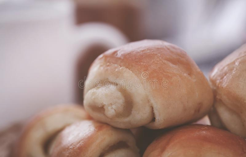 Rolled cinnamon bread. A popular snacks taking with coffee stock images