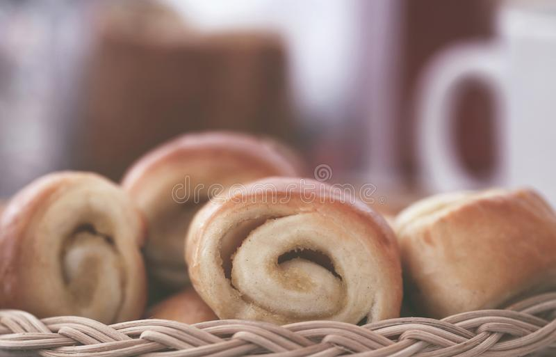Rolled cinnamon bread. A popular snacks taking with coffee stock photos