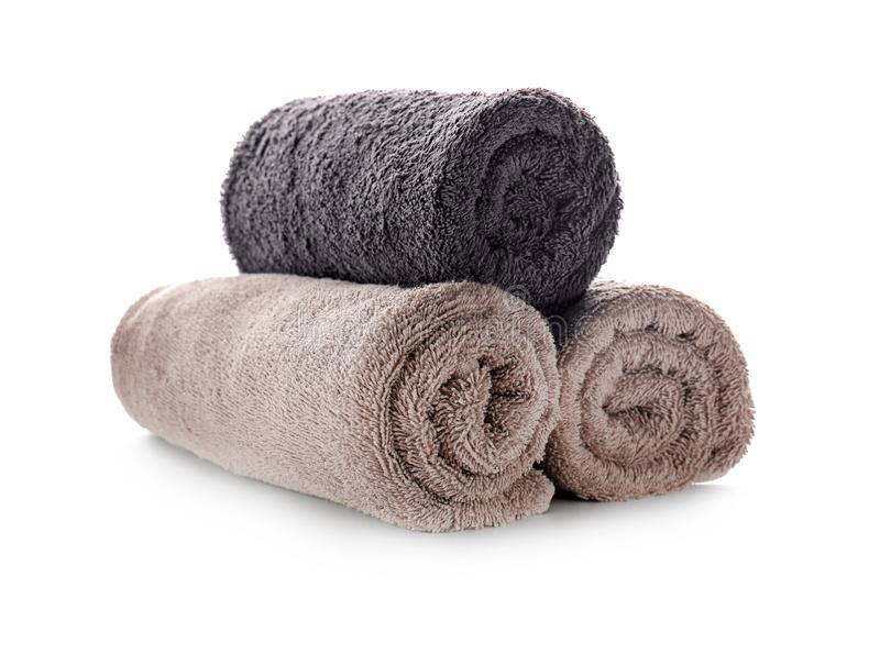 Rolled clean soft towels on white background stock photo
