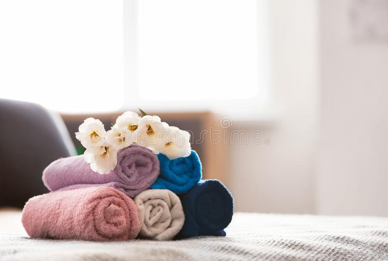 Rolled clean towels on bed royalty free stock photos