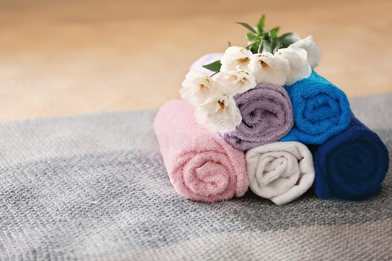 Rolled clean towels on bed royalty free stock photo