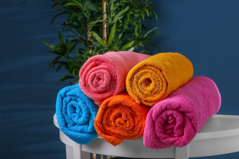 Rolled clean towels on table stock photo