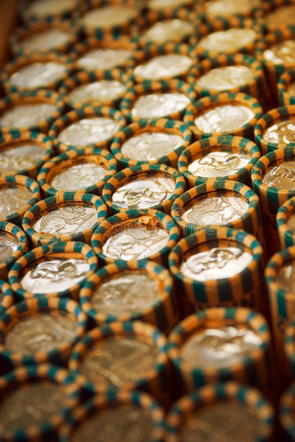 Rolled coins stock image