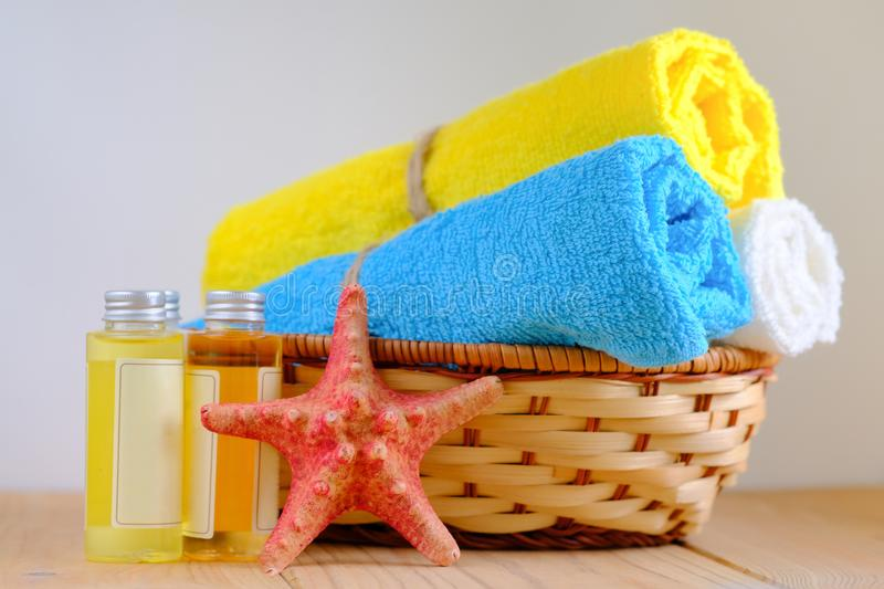 Rolled cotton towels and body care products stock photos