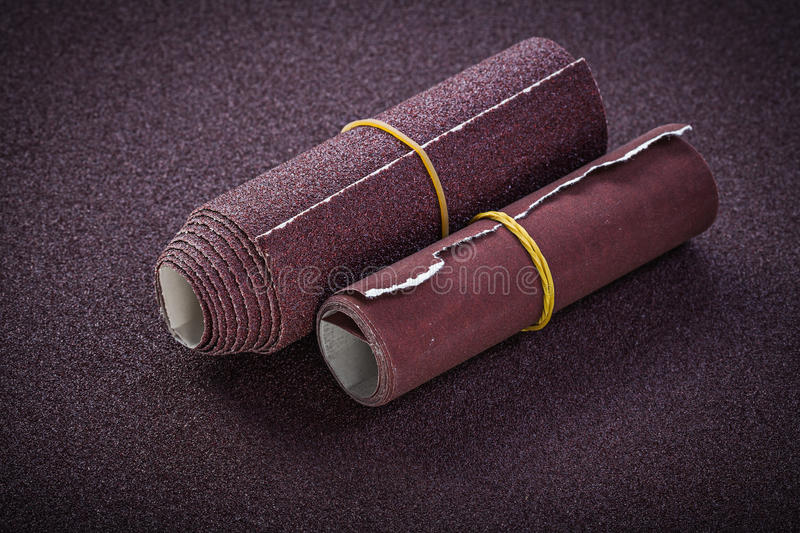 Rolled emery paper top view abrasive tools royalty free stock images