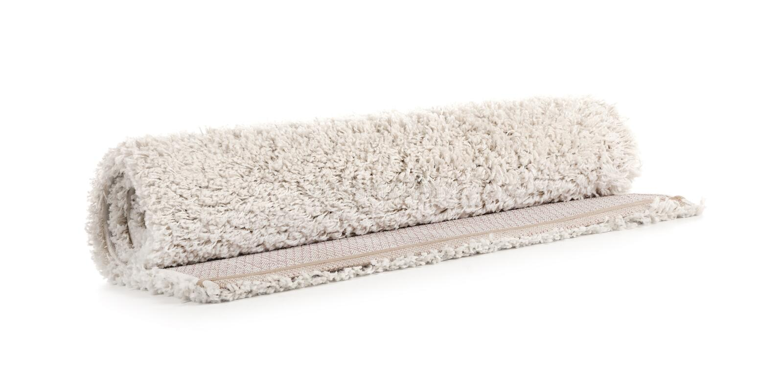 Rolled fuzzy carpet on white background. Interior element royalty free stock photography