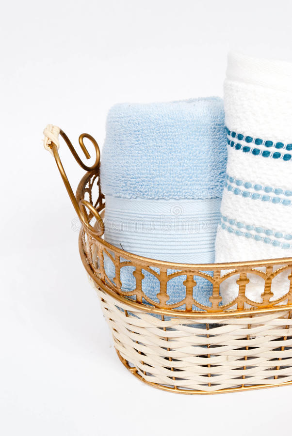 Rolled Hand Towels. In a gold basket royalty free stock images