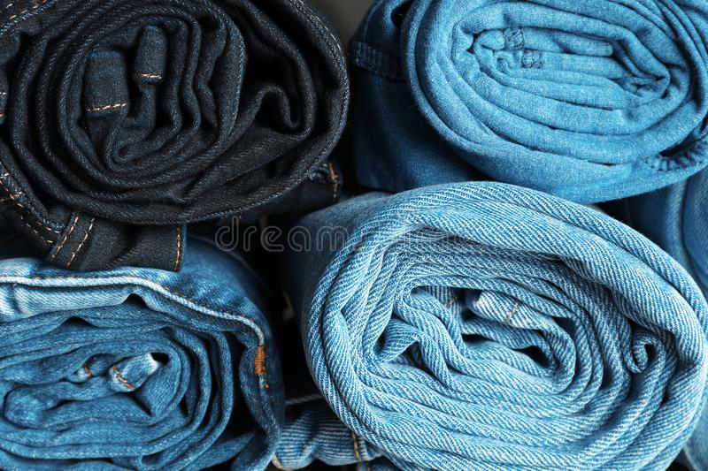 Rolled jeans of different colors stock photos