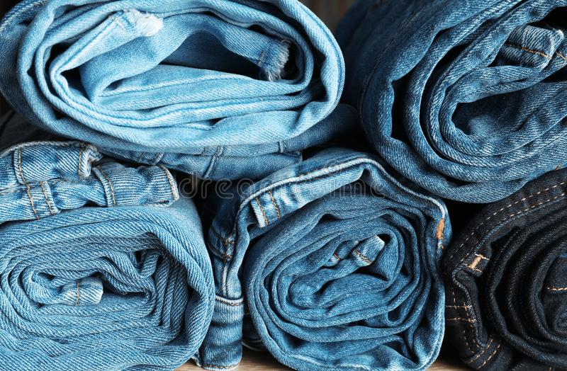Rolled jeans of different colors royalty free stock photos