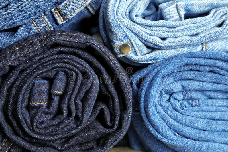 Rolled jeans of different colors royalty free stock images