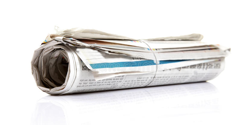 Rolled newspaper stock images
