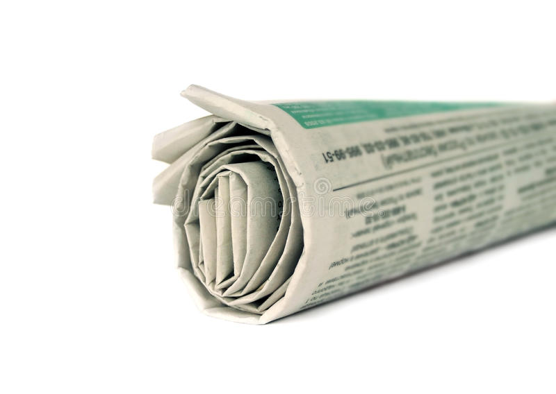 Rolled newspaper isolated stock image