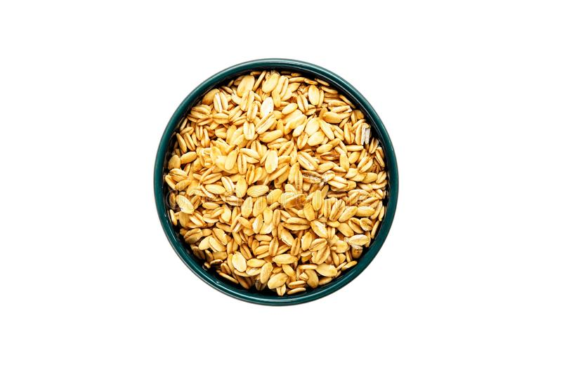 Rolled oats or old-fashioned oats in blue ceramic bowl on white background. Balanced diet and healthy eating concept stock image