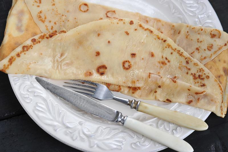 Rolled pancake on plate stock photo