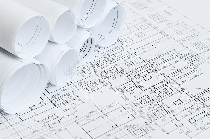 Rolled papers of design drawings stock photography