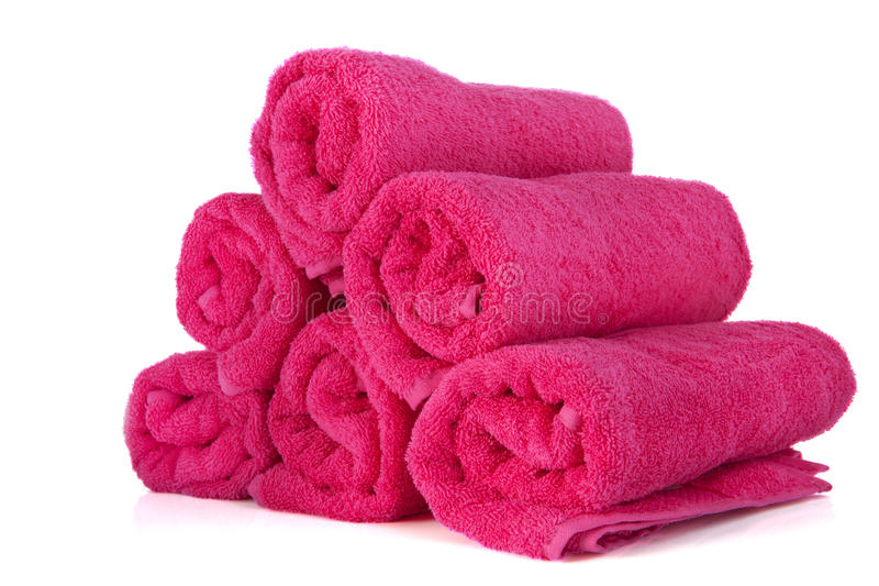 Rolled pink towels. Isolated over white background royalty free stock photography