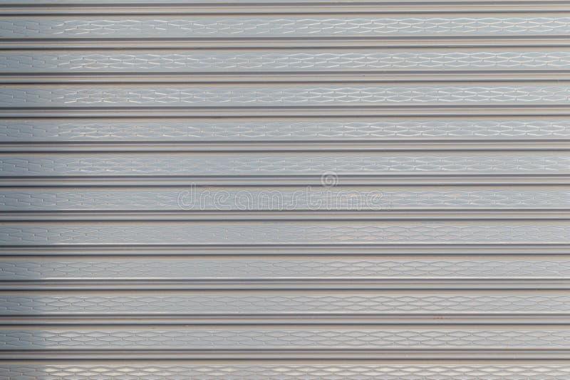 Rolled Plastic Shutter Door royalty free stock photo