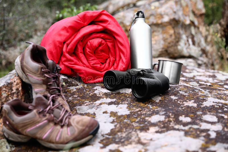 Rolled sleeping bag and other camping gear. Outdoors stock images