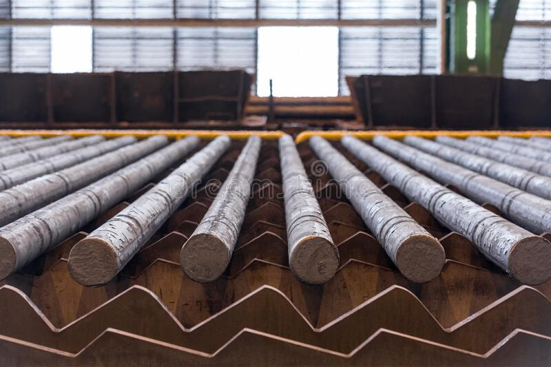 Rolled steel on the production line. Heavy metallurgical industry concept stock photo
