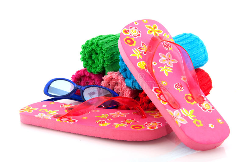 Rolled towels. Colorful rolled towels from terry with flip flops for vacation stock image
