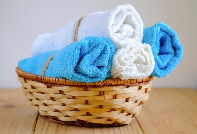 Rolled towels. Fresh blue and white rolled towels stock photo