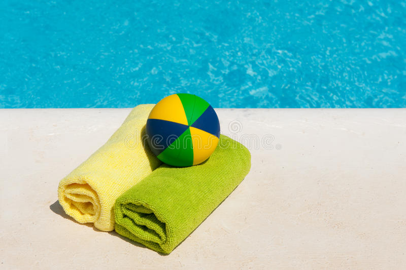 Rolled towels and toys. Near the swimming pool royalty free stock photography