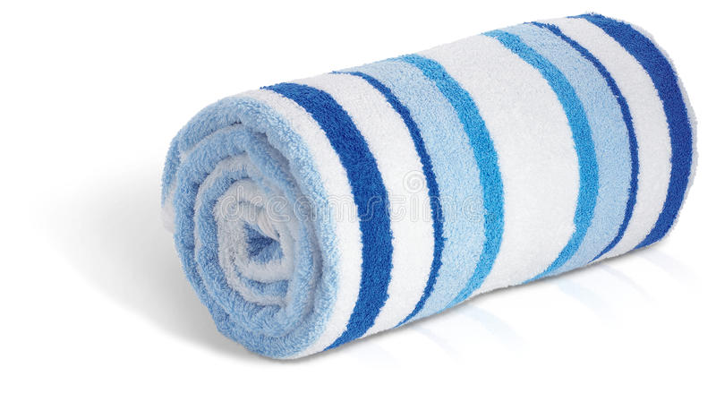 Rolled up blue and white beach towel on a white ba royalty free stock photo