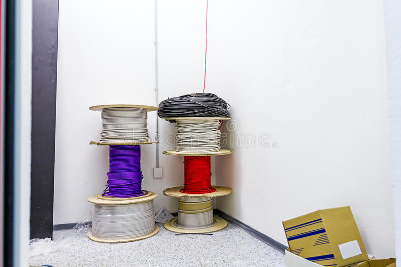 Rolled up cable spool, different type and color. Stacked various cable spools are waiting to be used in new edifice stock photography