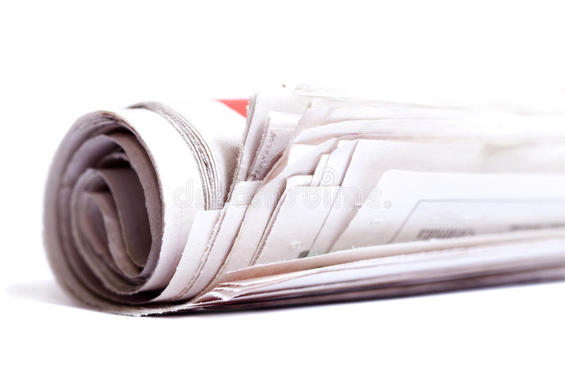 Rolled up newspaper. Rolled up newspaper isolated on white background stock photos