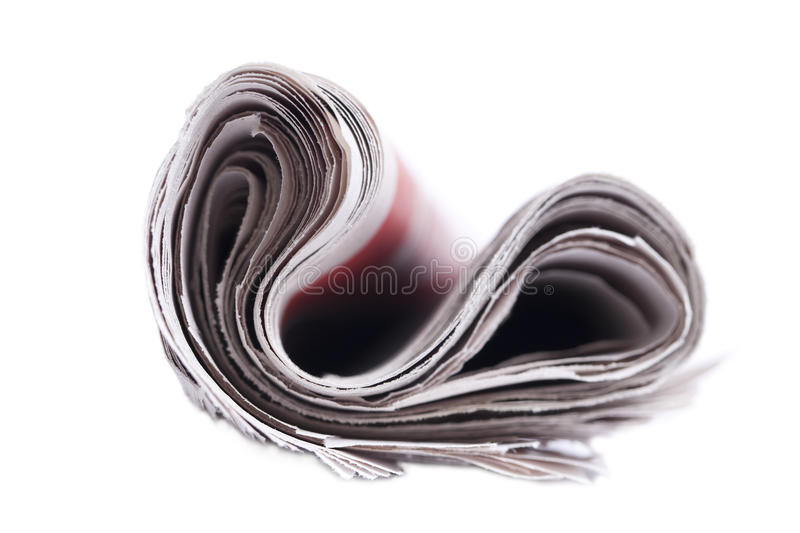 Rolled up newspaper. Rolled up newspaper isolated on white background stock images