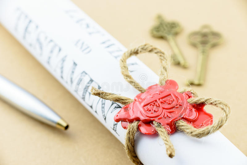 Rolled up scroll of Last will and testament that fastened with natural brown jute twine hemp rope. stock photos