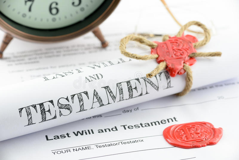 Rolled up scroll of last will and testament fastened with natural brown jute twine hemp rope. royalty free stock image