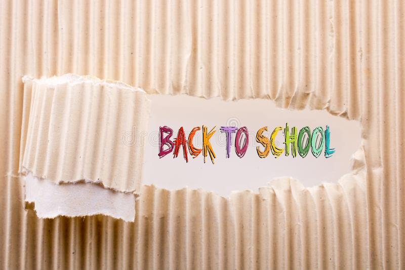 Rolled up torn paper. Back to school wording as educational concept royalty free stock photo
