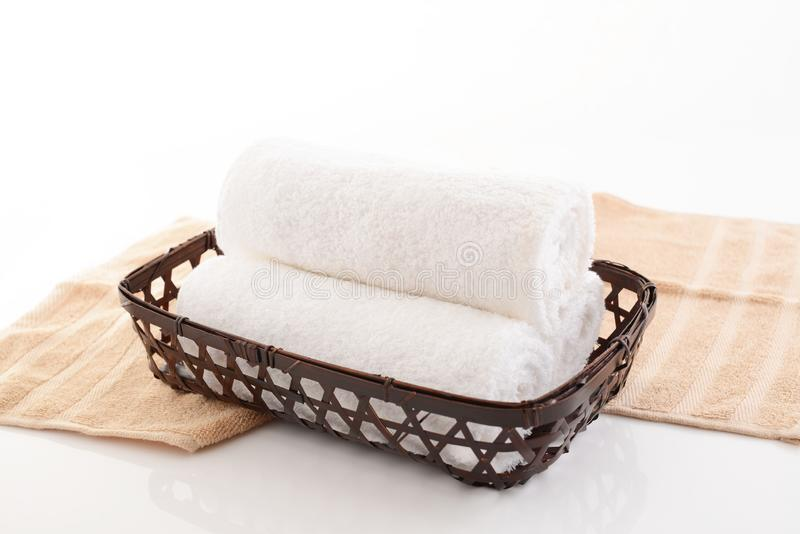 Rolled up towels. In a basket royalty free stock image