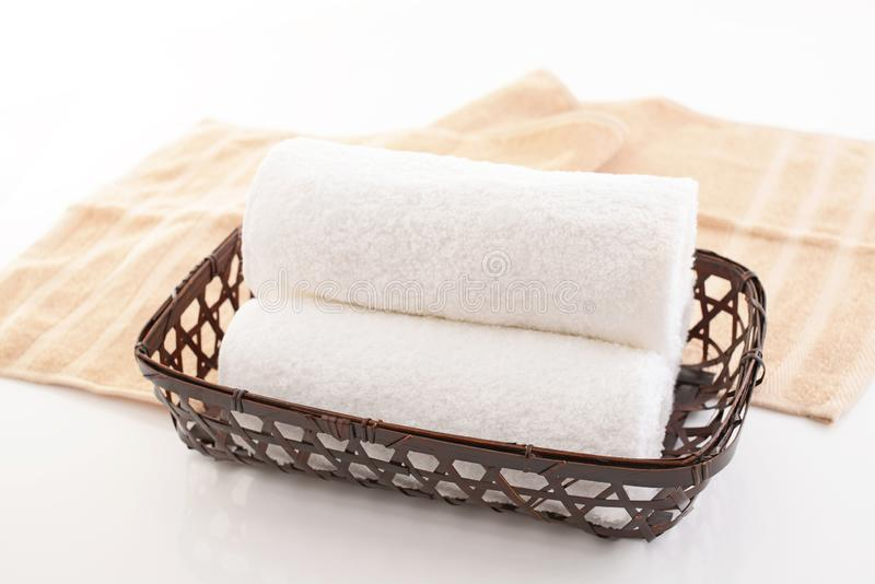 Rolled up towels. In a basket stock photo