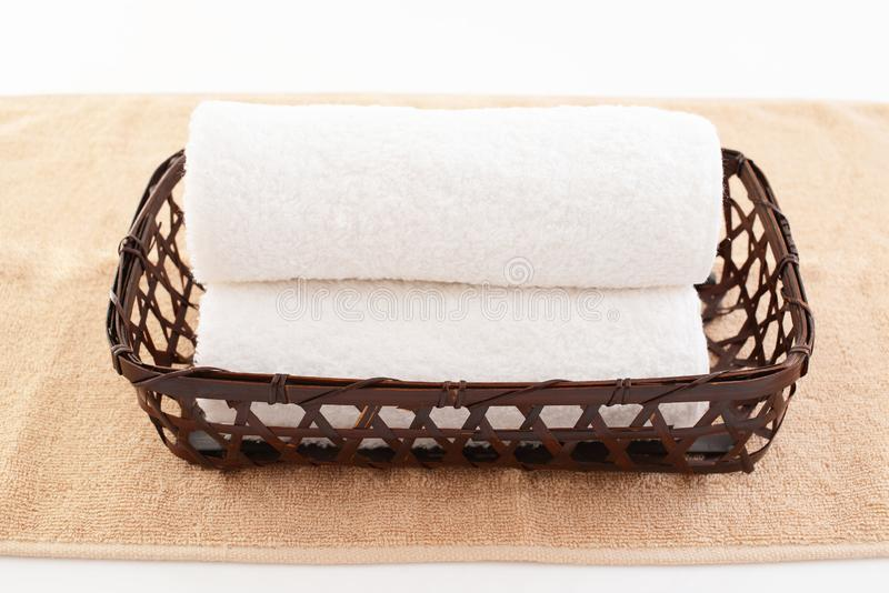 Rolled up towels. In a basket stock photos