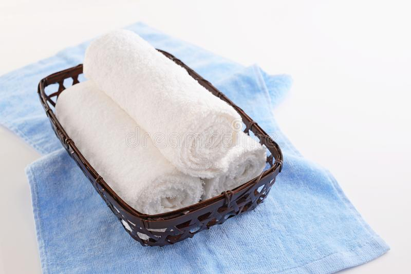 Rolled up towels. In a basket royalty free stock photos