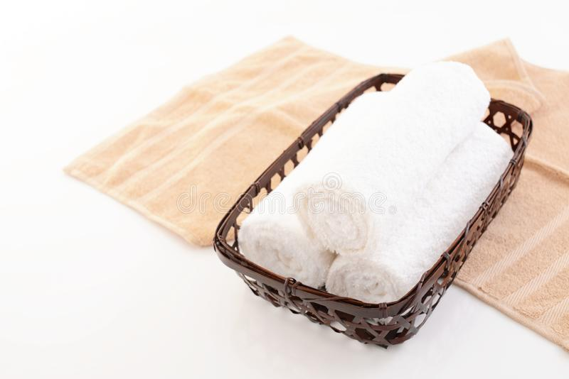 Rolled up towels. In a basket stock image