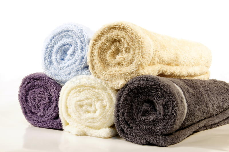 Rolled up towels. Clean, rolled up towels waiting for a buyer royalty free stock image