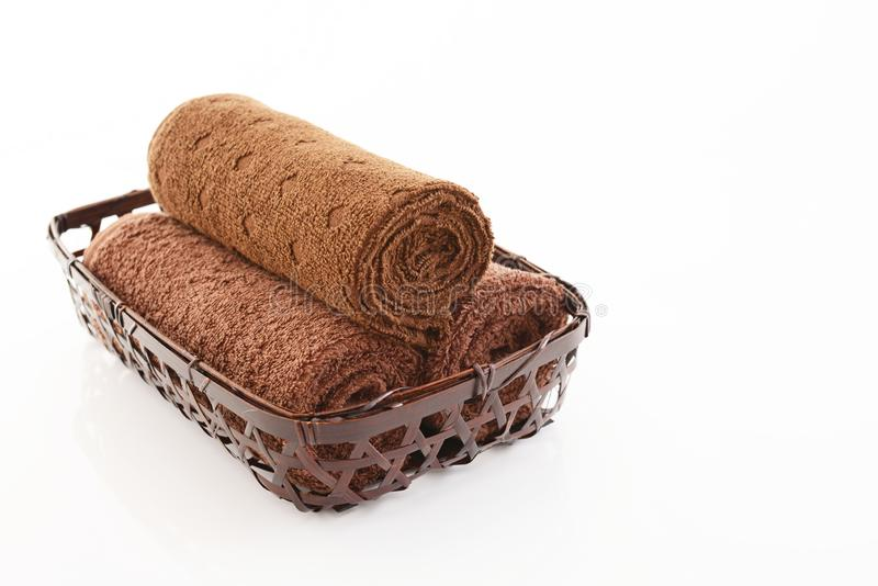 Rolled up towels. In a basket royalty free stock images