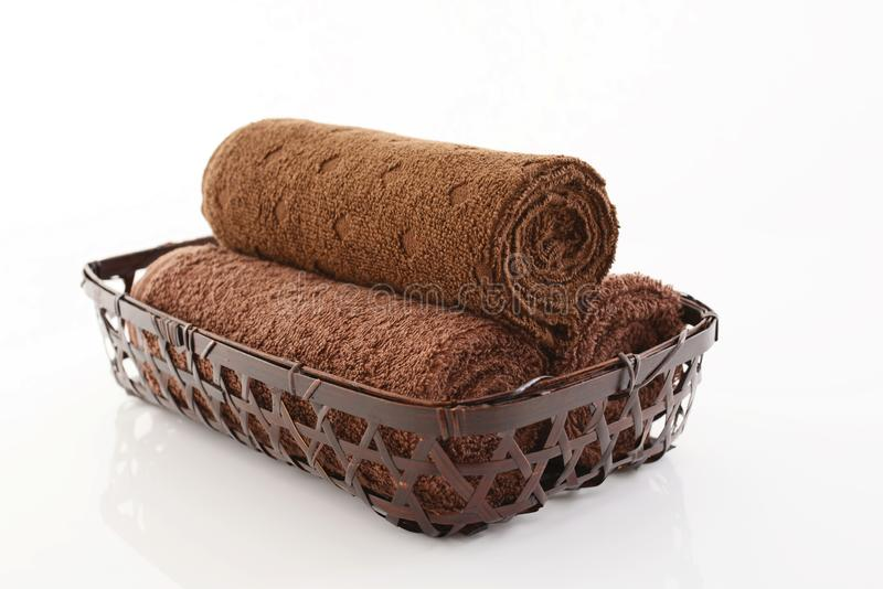 Rolled up towels. In a basket royalty free stock photo