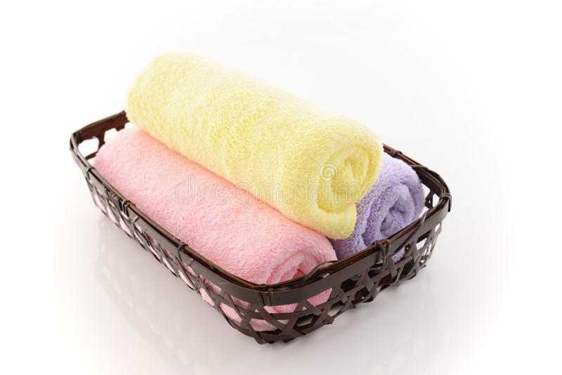 Rolled up towels. In a basket stock images