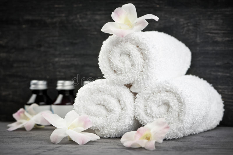 Download Rolled up towels at spa stock photo. Image of flowers - 24493298