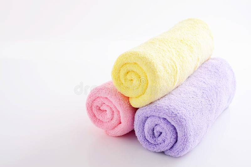 Rolled up towels. On a white background royalty free stock photo