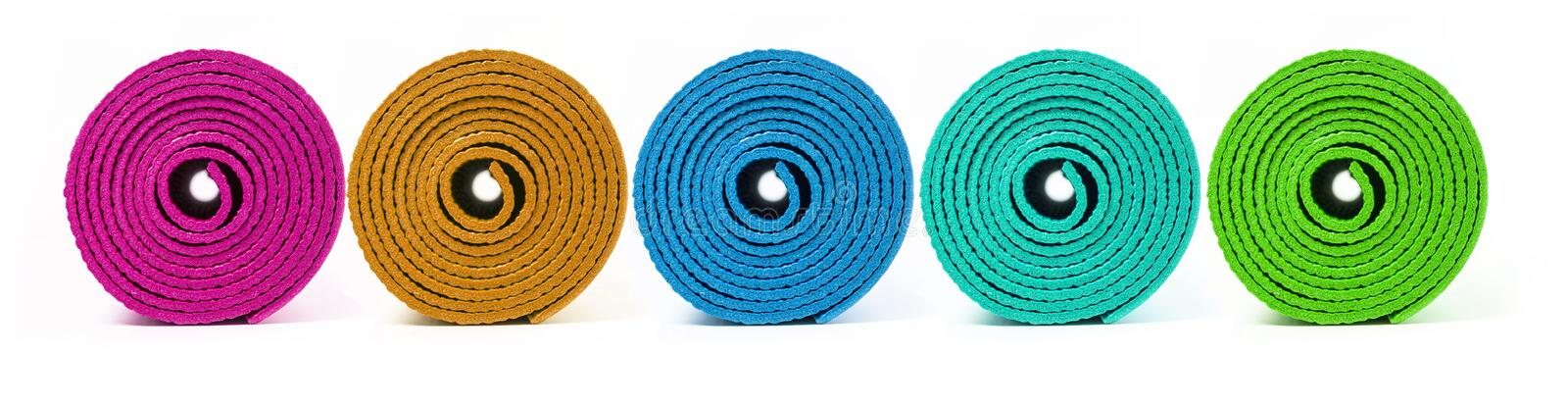 Rolled up yoga mat royalty free stock photography
