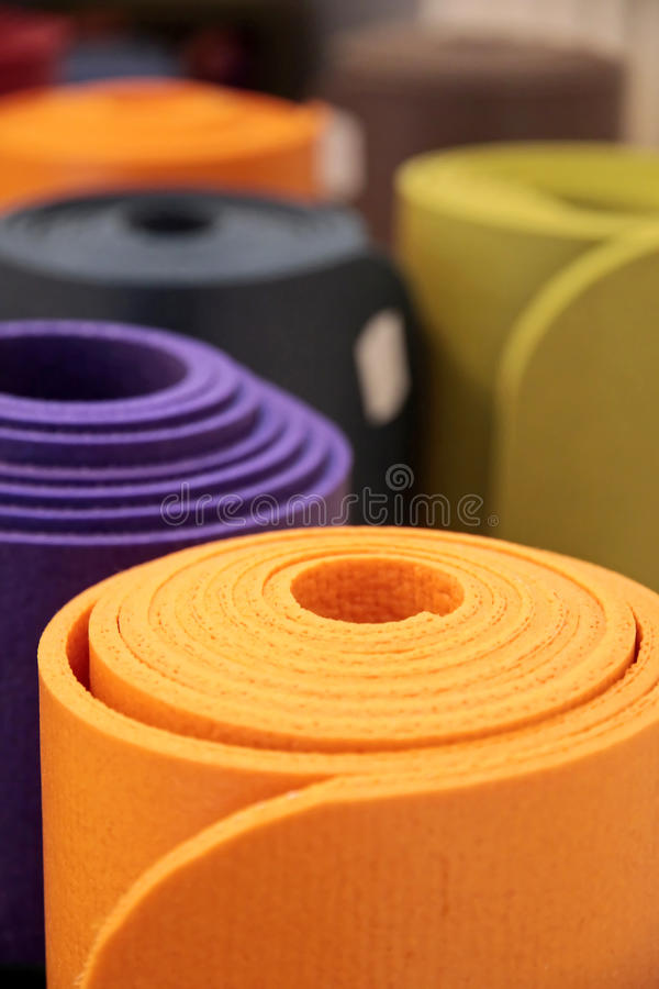 Rolled-up yoga mats royalty free stock images
