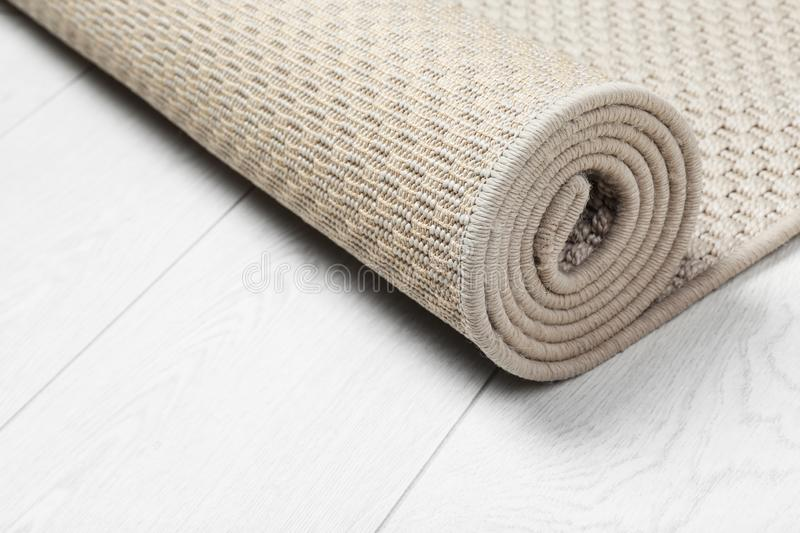 Rolled woven mat on wooden background. Space for text stock photography