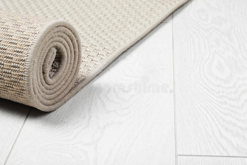 Rolled woven mat on wooden background. Space for text stock photos